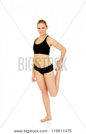 Young athletic woman stretching her leg