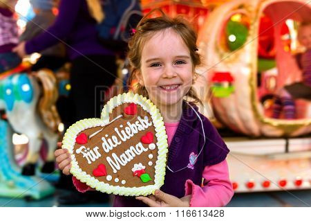 child with gingerbread heart