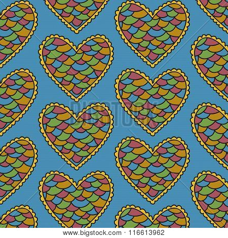 Decorative scaly heart seamless pattern on a blue background
