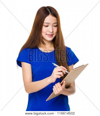 Woman writes with a clipboard