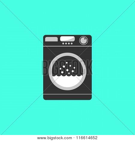 black washing machine isolated on green background