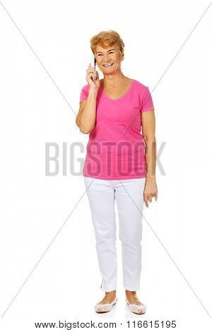 Smiling senior woman talking through phone