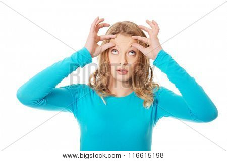 Woman checking wrinkles on forehead
