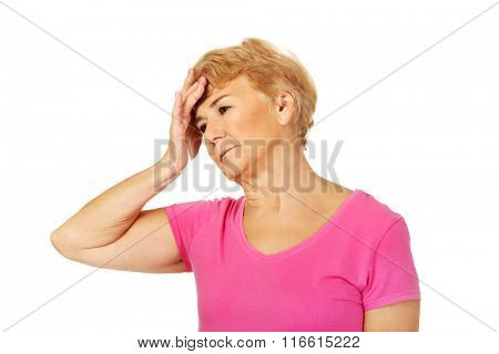Senior woman with huge headache