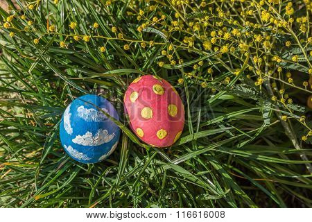 Easter Colored Eggs On The Grass