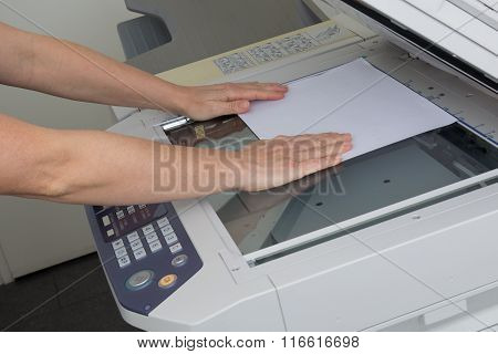 Happy Secretary Using  Photocopy Machine In  Office