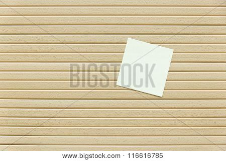 paper note on a wooden textured background