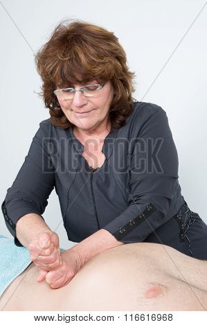Macro Close Up Of Hands Massaging Male Abdomen.therapist Applying Pressure On Belly.