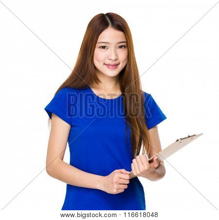 Smiling volunteer woman holding clip board