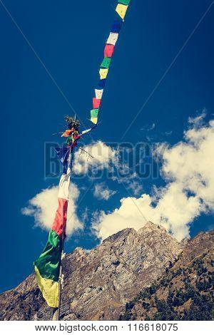 Prayer flags on a pole.