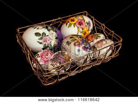 Colorful Easter Eggs Stacked In Golden Wire Basket, Symbol Of Springtime, Dark Background