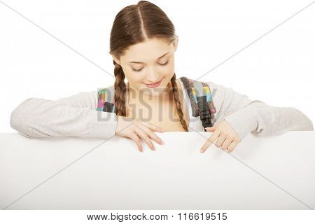 Young woman with blank billboard.