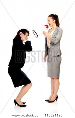 Businesswoman screaming in megaphone.