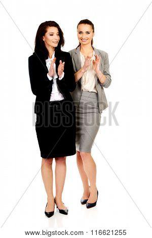 Happy two businesswomen applauding.