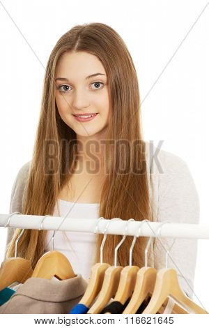Teen woman thinking what to put on.