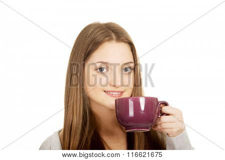 Teen woman with a cup of tea.