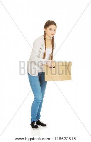 Tired woman holding carton box.