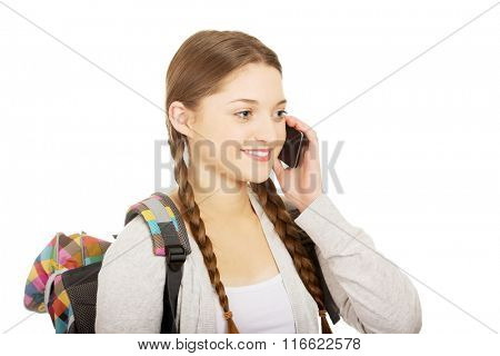 Teen with backpack with mobile phone.