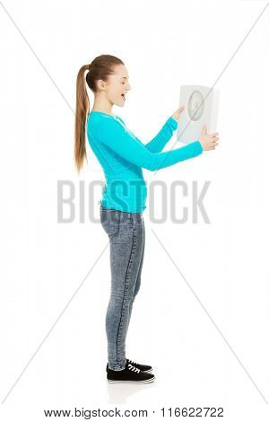Young unhappy woman with scale.
