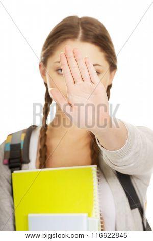 Teenager girl backpack make stop gesture.