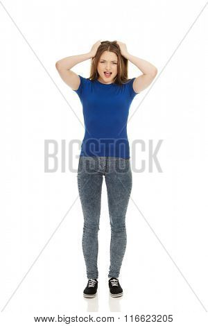 Frustrated young woman screaming.