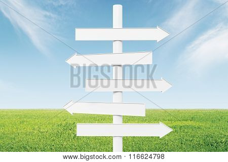 Blank White Arrows-pointers At Green Grass And Blue Sky Background, Mock Up