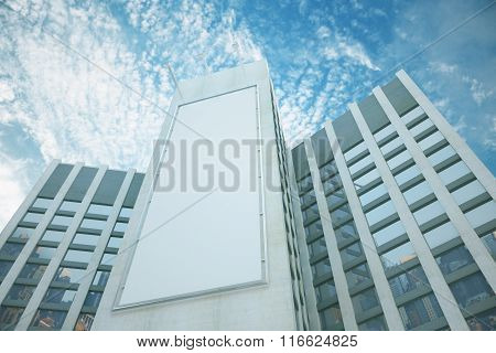 Blank White Billboard Between Business Centers At Blue Sky Background, Mock Up