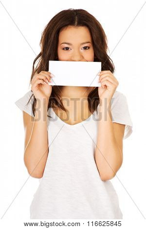 Young happy woman with blank paper.