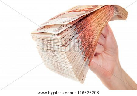 Hand With Stack Of Russian Roubles Bills Isolated On The White Background