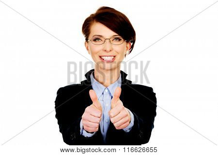 Smiling businesswoman with thumbs up.