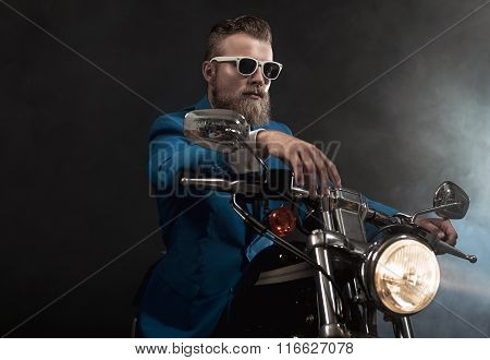 Trendy Businessman On A Motorbike