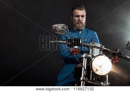 Handsome Businessman On A Motorbike