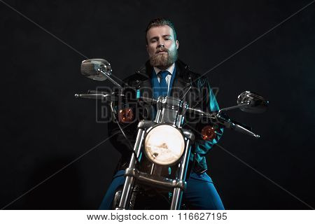Stylish Businessman Waiting On His Motorbike