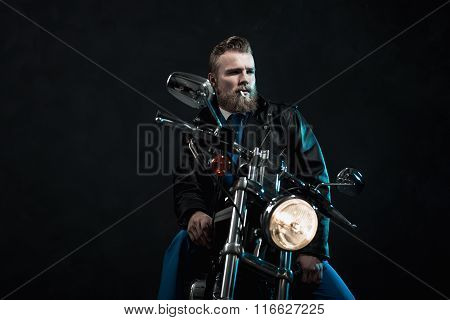 Macho Businessman Riding His Motorbike
