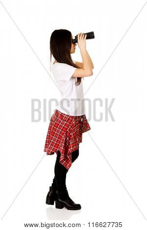 Young woman with binoculars.