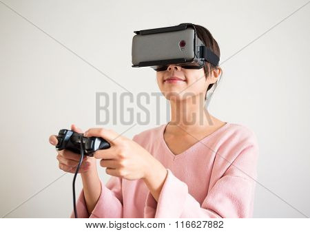 Asian Woman wearing virtual reality headset
