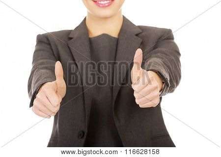 Business woman showing thumbs up.