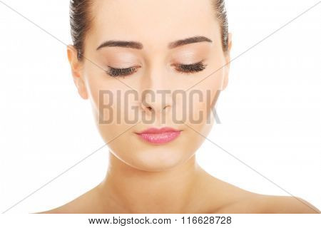 Woman with makeup and eyes closed.