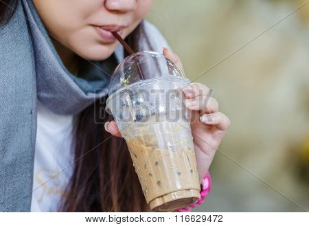 Woman Suck Ice Coffee