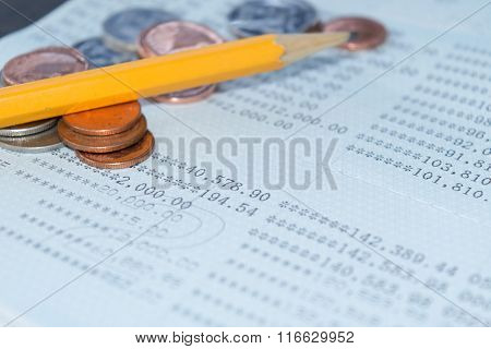 Saving Account Passbook Bank Account And Pencil And Coin Abstract Background