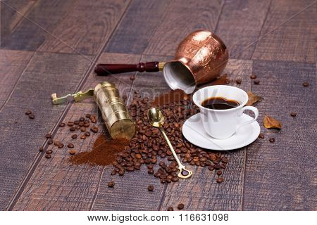 Coffee grinder, pot and grains