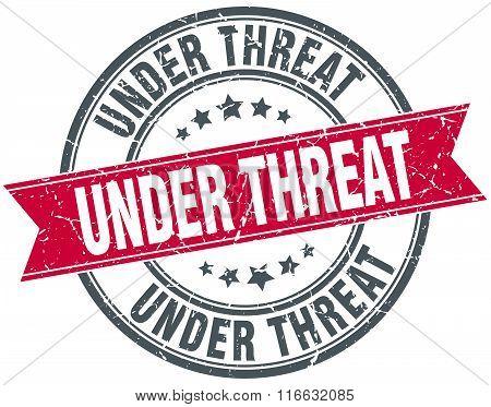 Under Threat Red Round Grunge Vintage Ribbon Stamp