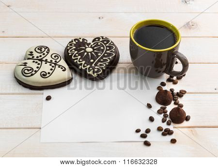 gingerbread cookies in the form of heart and coffee cap  on a wooden background