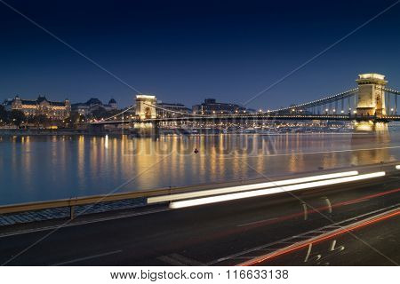 Stunning night cityscape of Budapest with illuminated Chain Bridge in the background.