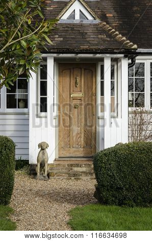 Cottage Door And Dog Statue