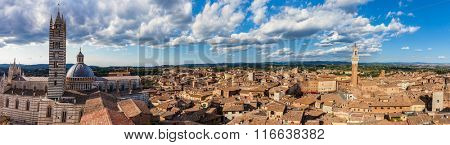 Siena, Italy panorama rooftop city view. Siena Cathedral and Mangia Tower. Tuscany region