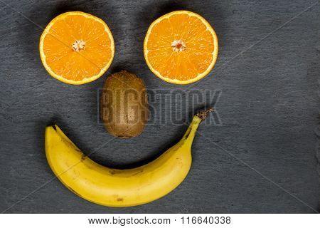 Smiling fruit face. Happy fruit face