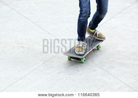 closeup of skateboader legs riding skateboarder at skatepark