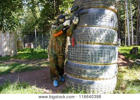 Paintball Player Behind Giant Truck Tire Fortification