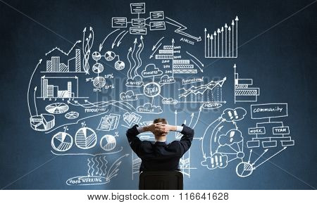Businessman drawing business strategy